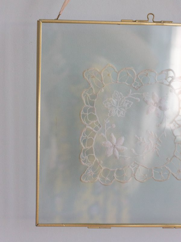 vintage embroidery in glass frame